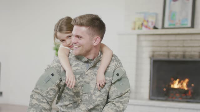 military dad hugging his young daughter - military recruit stock videos & royalty-free footage