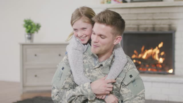 military dad hugging his young daughter - army soldier stock videos & royalty-free footage