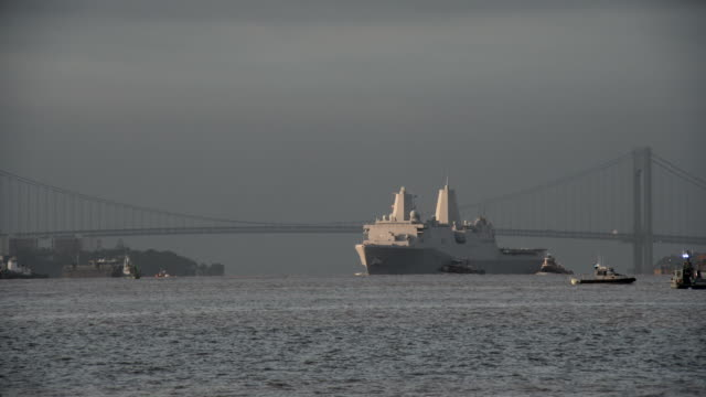 A military destroyer The USS New York LPD-21 comes into New York Harbor with the Verrazano behind