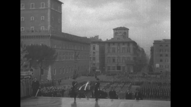 military display in piazza venezia with soldiers at attention surrounded by buildings and view down street / neville chamberlain's car and others... - rome italy stock videos & royalty-free footage
