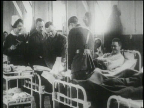 military doctors tend to injured soldiers in a military hospital. - 1918 stock videos & royalty-free footage