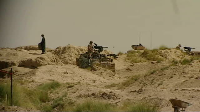 military dogs train at special kennels to prepare for duty in war zones t25080828 kandahar province maywand district ext long shot soldier on lookout... - 装甲車点の映像素材/bロール