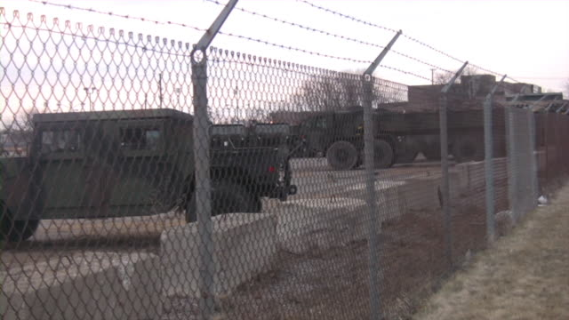 military equipment. army trucks and cars. secured area. - us military stock videos & royalty-free footage
