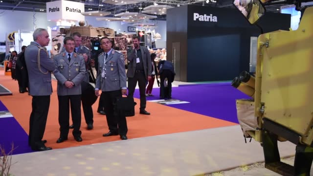 military equipment on display at the kmw stand during the defence and security exhibition 2015 at excel on september 15, 2015 in london, england.... - security equipment stock videos & royalty-free footage