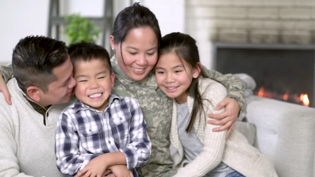 military family sitting on couch - military recruit stock videos & royalty-free footage