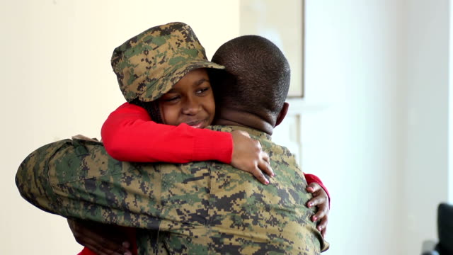 Military Father Embraces his Daughter