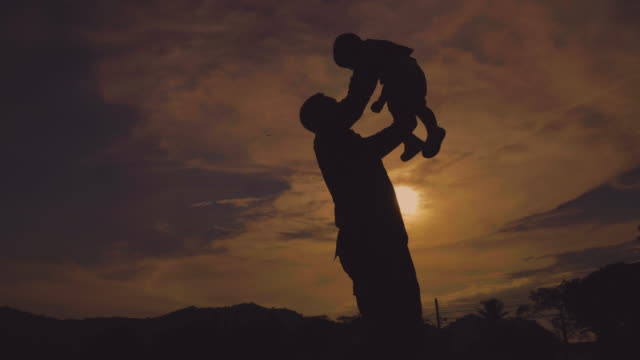 military father embraces his son in park - military stock videos & royalty-free footage