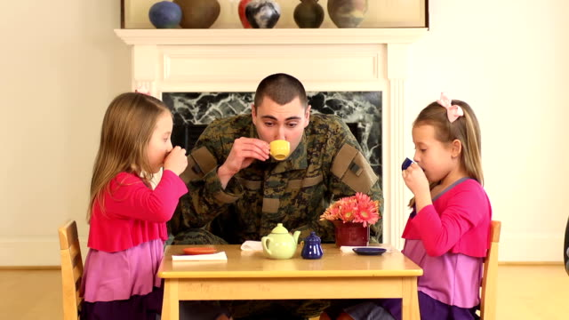 Military Father Playing with His Young Daughters