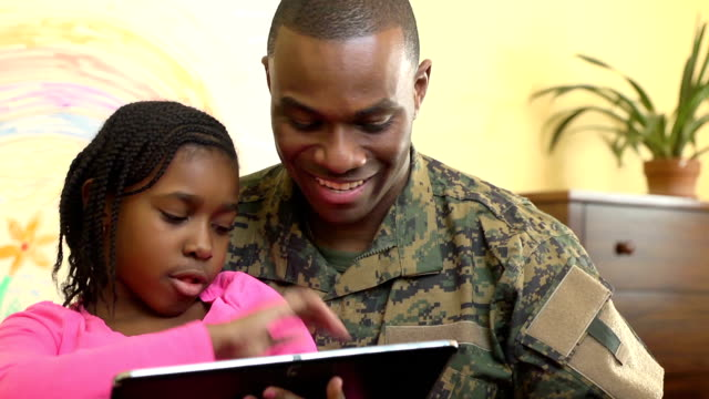 Military Father Plays on Digital Tablet with Daughter