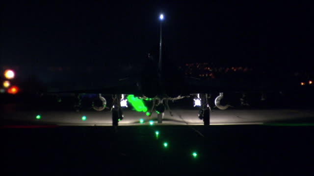 military fighter jet on a runway at night - military airplane stock videos & royalty-free footage