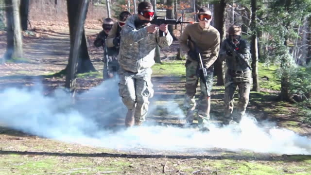 stockvideo's en b-roll-footage met a military group practices a drill. - slow motion - model released - hd - oefenen