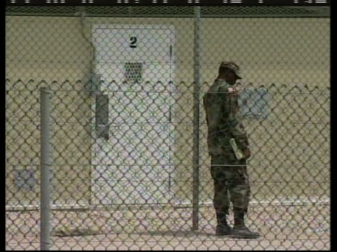 a military guard stands outside of cell 2 at the camp delta section of guantanamo bay - crime or recreational drug or prison or legal trial stock-videos und b-roll-filmmaterial