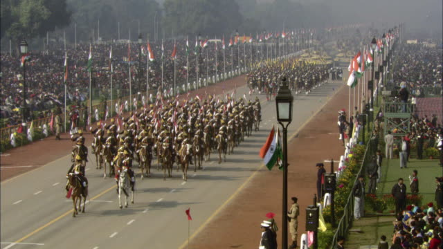 ha ws military guardsmen riding on horseback down street in india republic day parade during 58th republic day of india celebration on january 26, 2007 / india - military parade stock videos & royalty-free footage