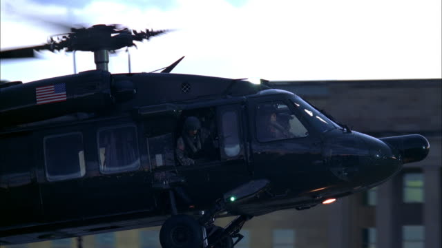 a military helicopter comes in for a landing near the pentagon. - helicopter landing stock videos & royalty-free footage