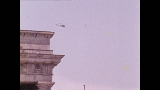 us military helicopter flies over brandenburg gate; 1970 - establishing shot stock videos & royalty-free footage