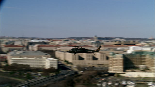 a military helicopter flies over the jefferson memorial in washington, d.c.. - jefferson memorial stock videos & royalty-free footage