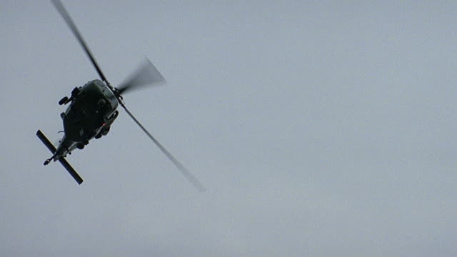 slo mo ws la pan military helicopter flying past us flag / usa - military helicopter stock videos & royalty-free footage