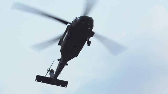 military helicopter flying - military helicopter stock videos & royalty-free footage