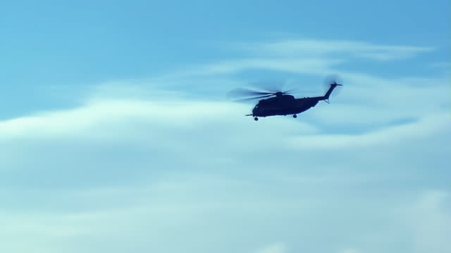 Military Helicopter in the blue sky
