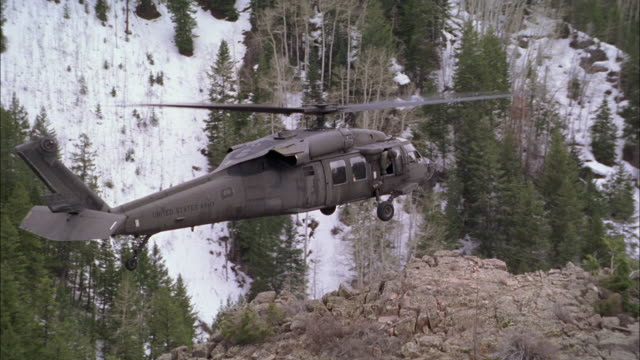 aerial, military helicopter landing on rocky mountain top, usa - air force stock videos & royalty-free footage
