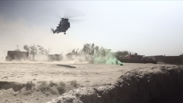 military helicopter landing - army stock-videos und b-roll-filmmaterial
