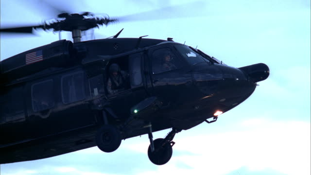 a military helicopter lands in front of the pentagon, then quickly takes off again. - military helicopter stock videos & royalty-free footage