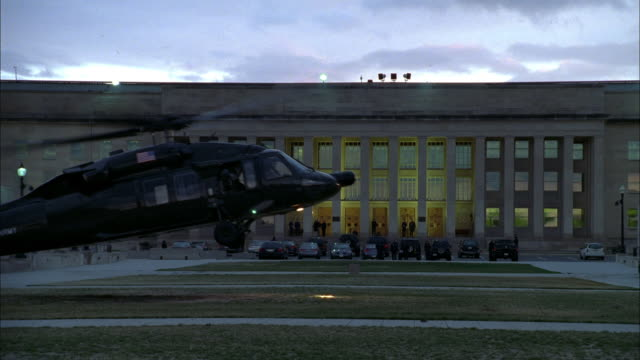 a military helicopter lands in front of the pentagon. - helicopter landing stock videos & royalty-free footage