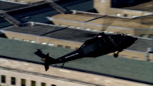 a military helicopter patrols over the pentagon near washington, dc. - military helicopter stock videos & royalty-free footage