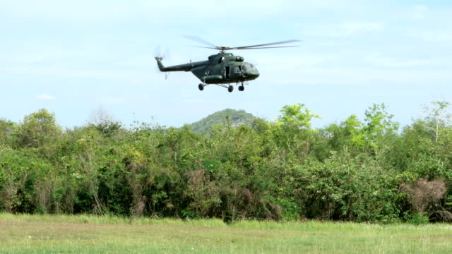 military helicopter take off from military training area. - helicopter landing stock videos & royalty-free footage