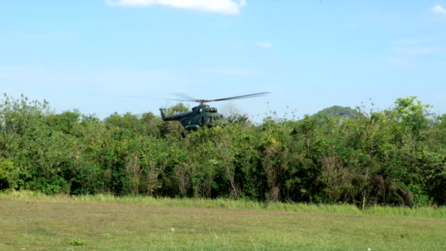 military helicopter take off from military training area. - military helicopter stock videos and b-roll footage
