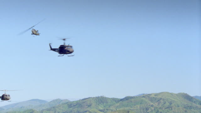 military helicopters cross paths over the mountains of vietnam. - 1987 stock videos & royalty-free footage
