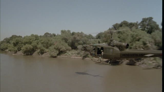 military helicopters fly over a river in vietnam. - military helicopter stock videos and b-roll footage