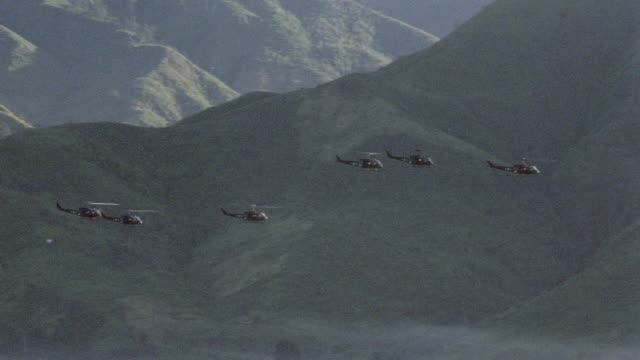 military helicopters fly over the mountains of vietnam. - 1987 stock videos & royalty-free footage