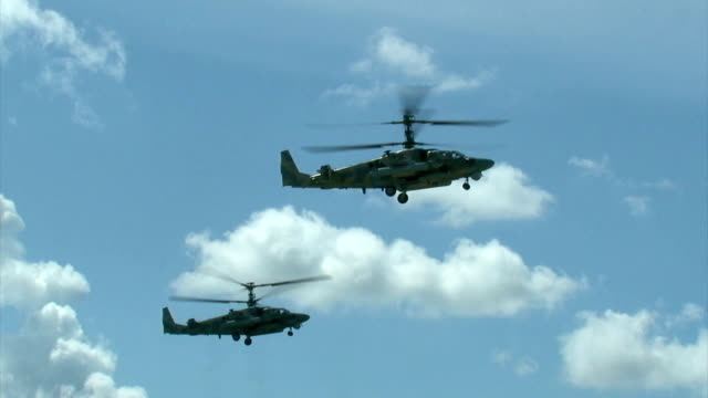 military helicopters in the cloudy sky - air raid stock videos & royalty-free footage
