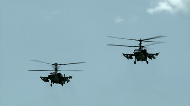 military helicopters in the sky - air raid stock videos & royalty-free footage