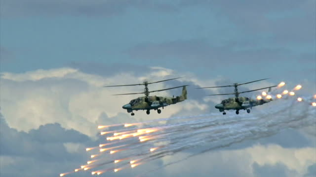 military helicopters practice missile defense - helicopter stock videos & royalty-free footage
