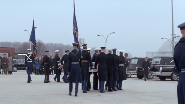 a military honor guard carries a coffin to a waiting hearse. - coffin stock videos & royalty-free footage