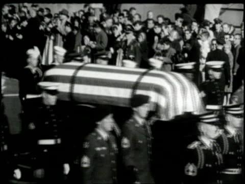vídeos de stock, filmes e b-roll de military honor guards escort the flagdraped coffin of president john f kennedy during his funeral - john f. kennedy