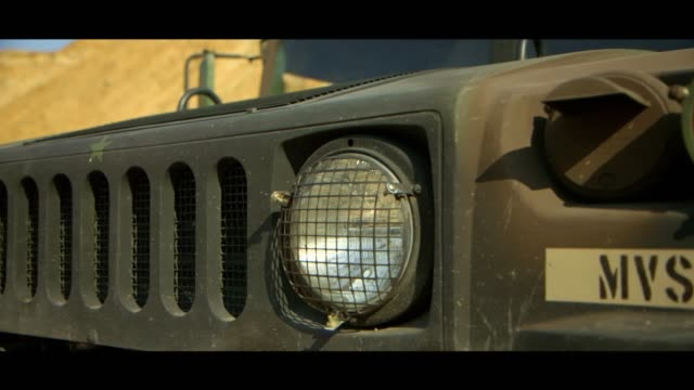 military hummer - headlights - bonnet stock videos & royalty-free footage