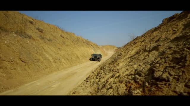military hummer in desert - matte image technique stock videos & royalty-free footage