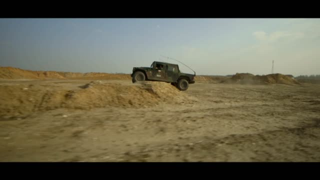 military hummer in desert - matte stock videos & royalty-free footage