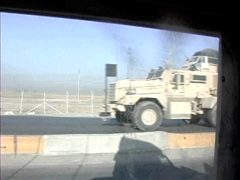 us military humvee driving on road past other military vehicles / baghdad iraq / audio - 2007 stock videos & royalty-free footage