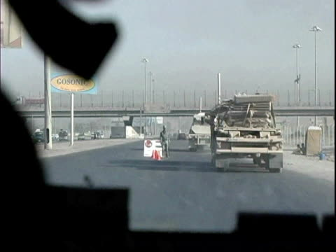 military humvee driving on road past soldiers / baghdad, iraq / audio - 2007 stock videos & royalty-free footage