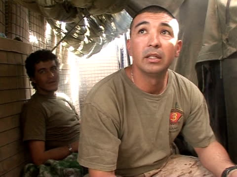 vídeos de stock, filmes e b-roll de military interpreters in rural southwest afghanistan put themselves on the front line without a weapon every day, working alongside us marines as... - 50 segundos ou mais
