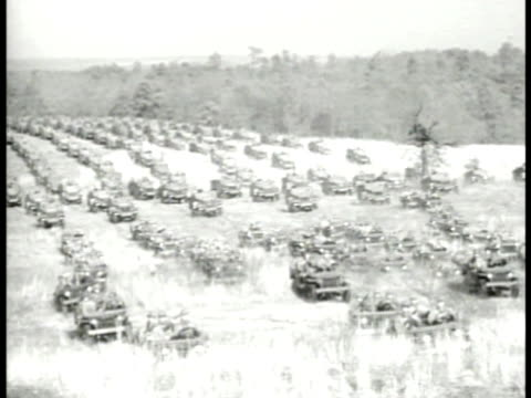 military jeeps moving on grass field. armored military trucks crossing field. . wwii - 1941 stock videos & royalty-free footage