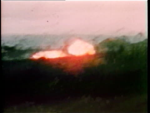 military jet airplanes dropping napalm bombs during vietnam war / bombs exploding on ground fireballs napalm bombing during vietnam war on june 01... - guerra del vietnam video stock e b–roll