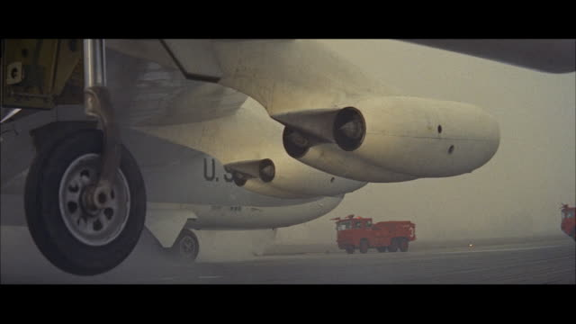 ms b 52 military jet bomber airplane and crash trucks up to front - 爆撃機点の映像素材/bロール