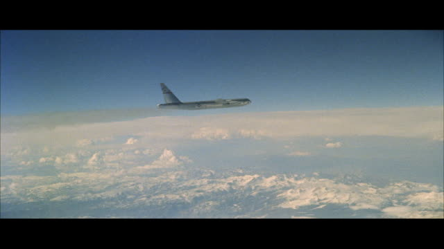 ws arial b 52 military jet bomber airplane in flying over mountains - bomber plane stock videos and b-roll footage
