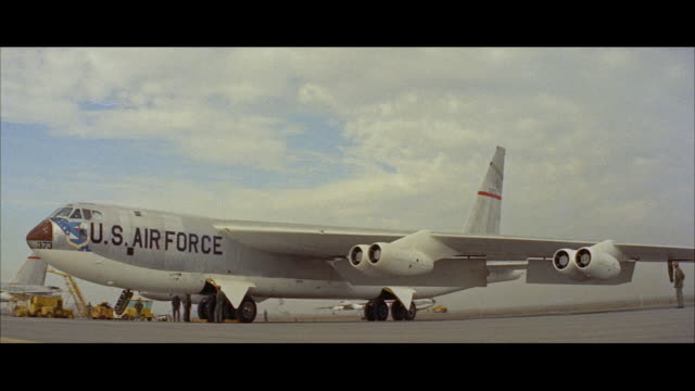 ws b-52 military jet bomber airplane sitting on parking area - anno 1957 video stock e b–roll
