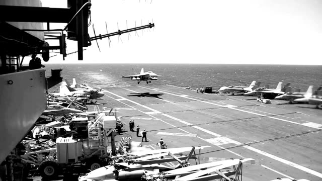 military jet landing on aircraft carrier. - aircraft carrier stock videos & royalty-free footage